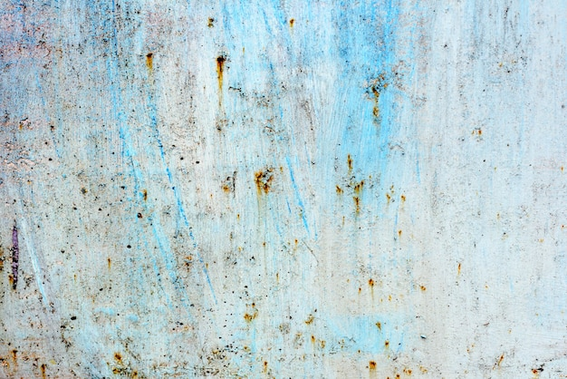 Texture of a metal wall with cracks and scratches