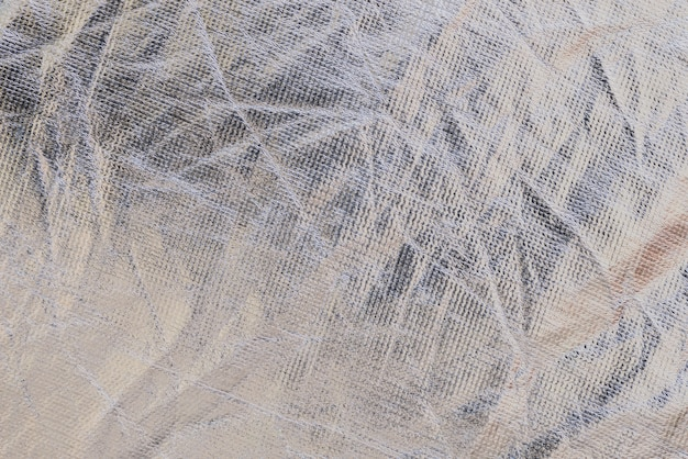 Texture of a metallic wrinkled plastic fabric background