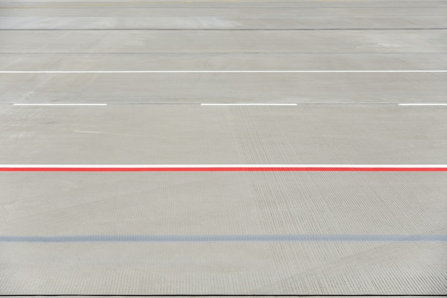 Texture of modern airport runway with stripes.