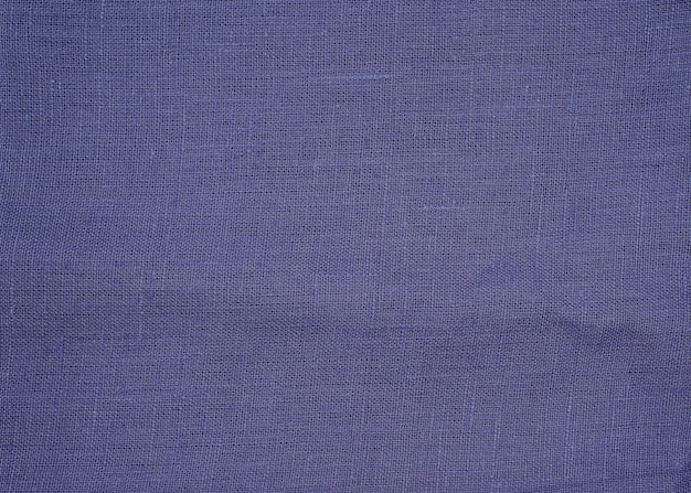 Texture of natural blue  or violet fabric or cloth. fabric texture of natural cotton or linen textile material.
