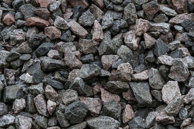 Texture of natural crushed stone on oad