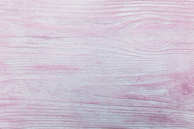 Texture of natural wood, painted in pink