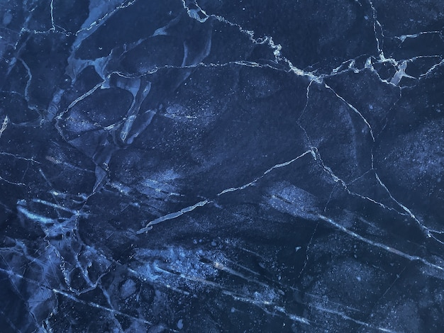 Texture of navy blue marble with lines, macro background