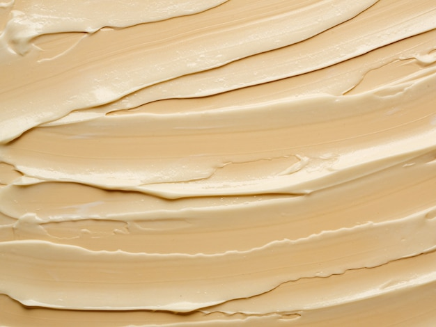 Texture of nude cream on beige background. stock photography