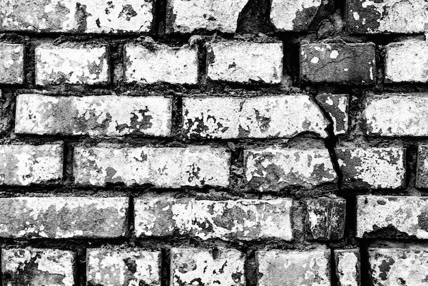 ひび割れや傷の背景でレンガの壁のテクスチャ