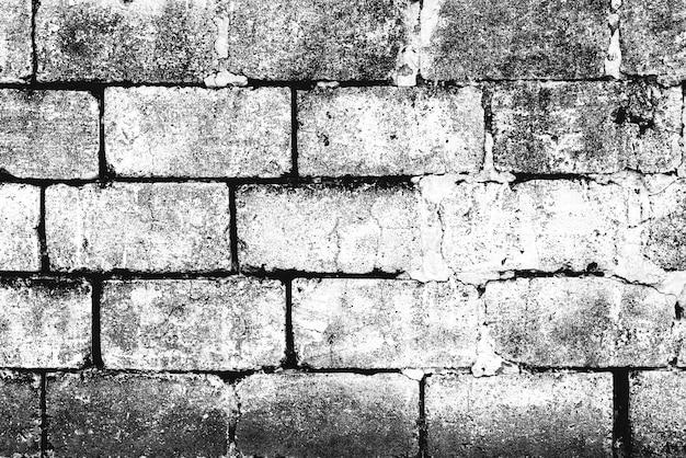 ひびや傷の背景とレンガの壁のテクスチャ