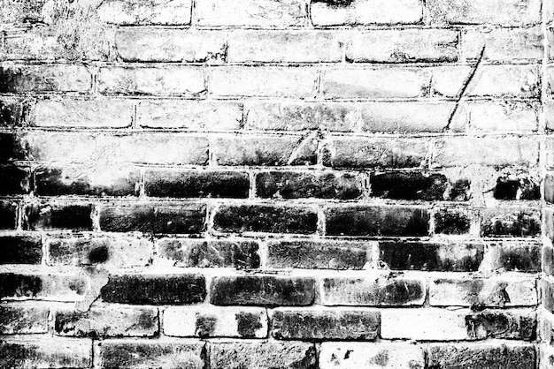 背景として使用できるひびや傷のあるレンガの壁の質感