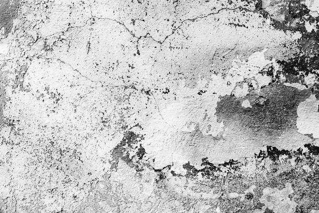 亀裂や傷の背景を持つコンクリートの壁のテクスチャ