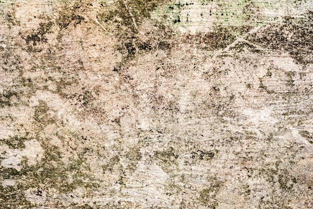 背景として使用できるひび割れや傷のあるコンクリート壁のテクスチャ