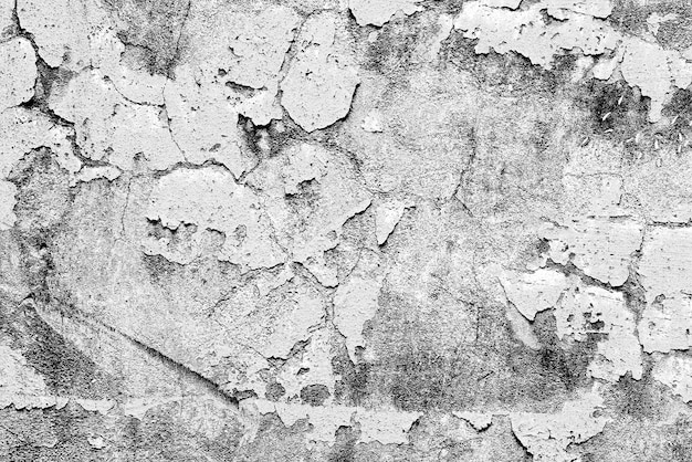 背景として使用できるひびや傷のあるコンクリート壁のテクスチャ