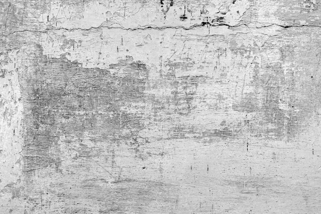 배경으로 사용할 수 있는 균열과 긁힌 자국이 있는 콘크리트 벽의 질감