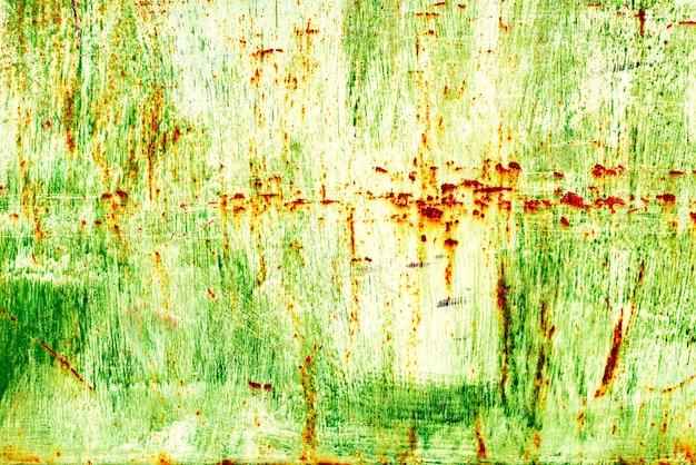 Текстура металлической стены с трещинами и царапинами, которую можно использовать в качестве фона