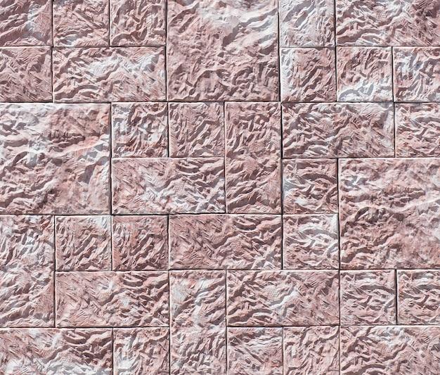 石垣の質感。古い城の石の壁のテクスチャの背景。背景またはテクスチャとしての石の壁。