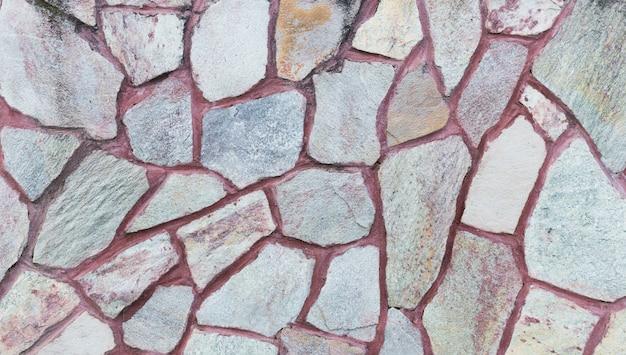 돌 담의 질감입니다. 오래 된 성 돌 벽 질감 배경입니다.