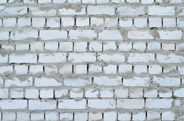 Текстура белой кирпичной стены с фоном цементных швов