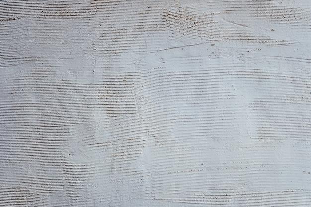 溝、空の背景の白い壁のテクスチャ。
