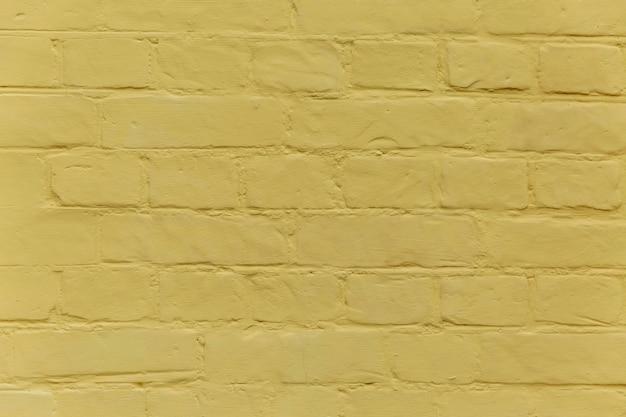 노란 벽돌 벽의 질감입니다. 배경. 텍스트를 위한 공간입니다.