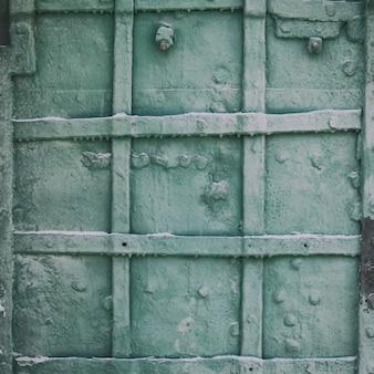 오래 된 금속 문 근접 촬영의 질감