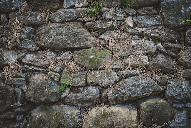 古い自然石の壁のテクスチャ