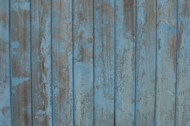 古い木の質感、ペンキでボード、ヴィンテージの背景の剥離ペイント。ひびの入った痛みのある古い青いボード