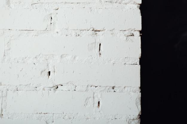오래 된 흰색과 검은 색 벽돌 벽의 질감. 추상 빈티지 배경