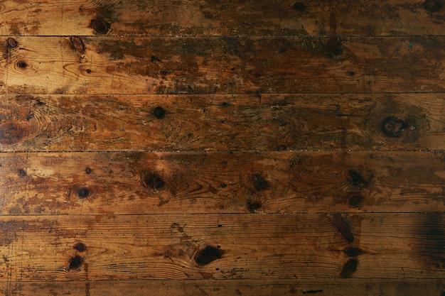 오래 착용 된 어두운 갈색 테이블 또는 바닥의 질감, 총을 닫습니다.