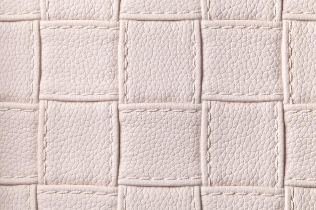 사각형 패턴 및 스티치, 매크로와 베이지 색 가죽 배경 텍스처.
