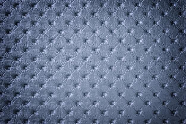 キャピトンパターン、マクロと青い革の背景のテクスチャ。チェスターフィールドスタイル。ヴィンテージ生地
