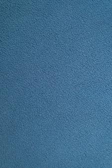 青い不均一なフリース綿生地の質感