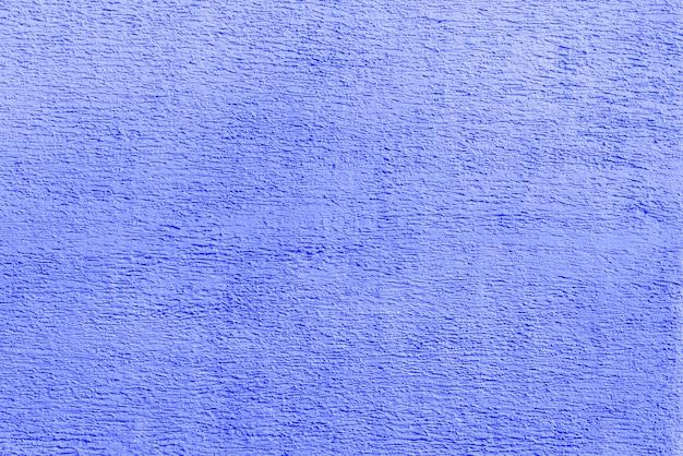 青い漆喰の質感。モダンなロフトのインテリア。抽象的なラフな背景。古い家のファサード。