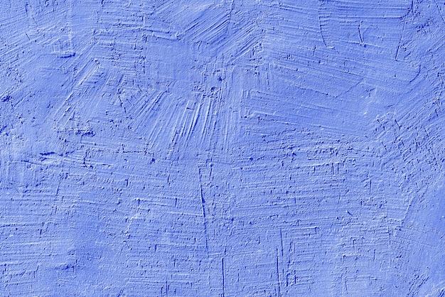 오래 된 집의 벽에 파란색 석고의 질감. 건축 설계.