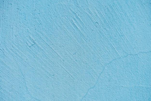 Текстура стены голубого камня или цемента в солнечном свете для картины, стены или 3d. горизонтальный, крупный план