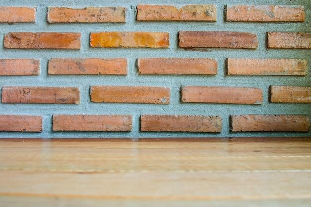 レンガの壁と木製のテーブルのテクスチャ