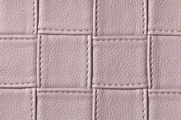 사각형 패턴 및 스티치, 매크로와 갈색 가죽 백그라운드의 질감.