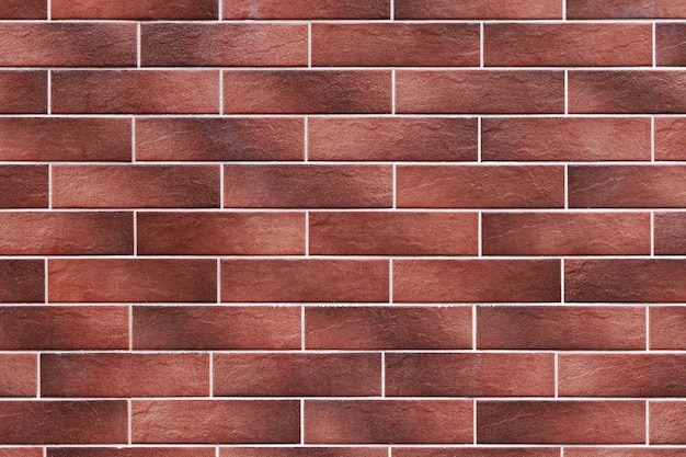 장식 타일 또는 벽돌의 갈색 벽의 질감.