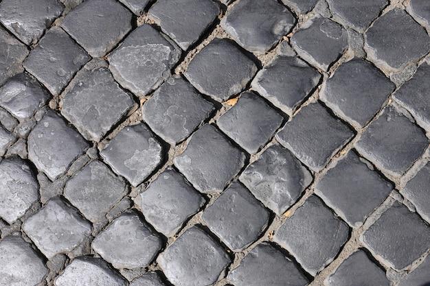 街の石畳の背景のテクスチャ。