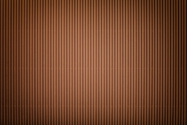 ビネット、マクロと段ボールダークブラウン紙の質感。縞模様のブロンズ段ボールの背景、クローズアップ。