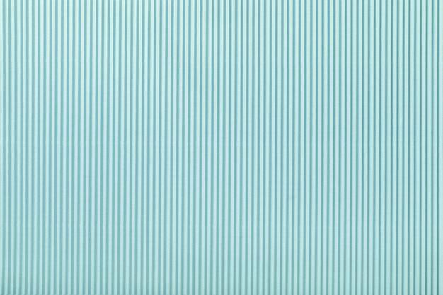 波状の水色の紙のテクスチャ、マクロ。