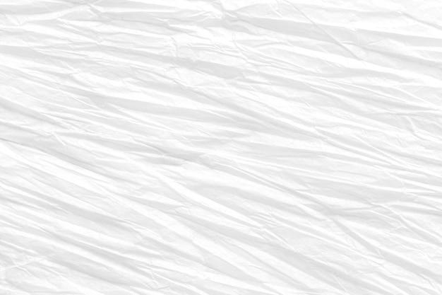 しわくちゃの紙、白い背景のテクスチャ