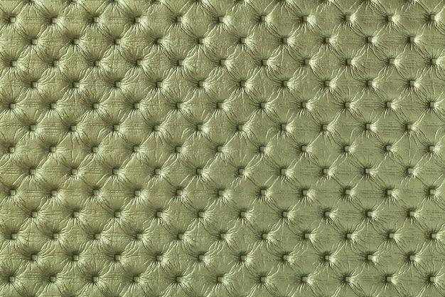 キャピトンパターンと濃い緑色の革の背景のテクスチャ