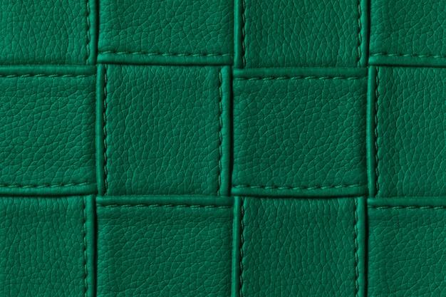 사각형 패턴 및 스티치와 어두운 녹색 가죽 배경 텍스처.