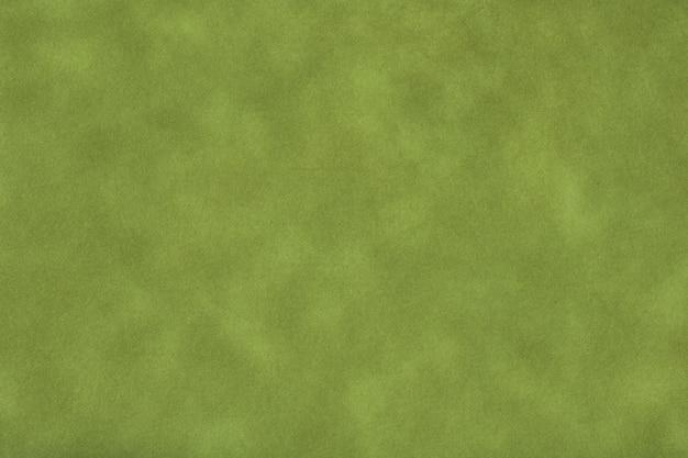 濃い緑色の古い紙の質感、しわくちゃの背景。ヴィンテージオリーブグランジ表面の背景。クラフト羊皮紙段ボールの構造。