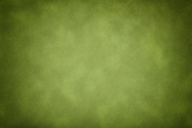 濃い緑色の古い紙のテクスチャ、ビネットでしわくちゃの背景