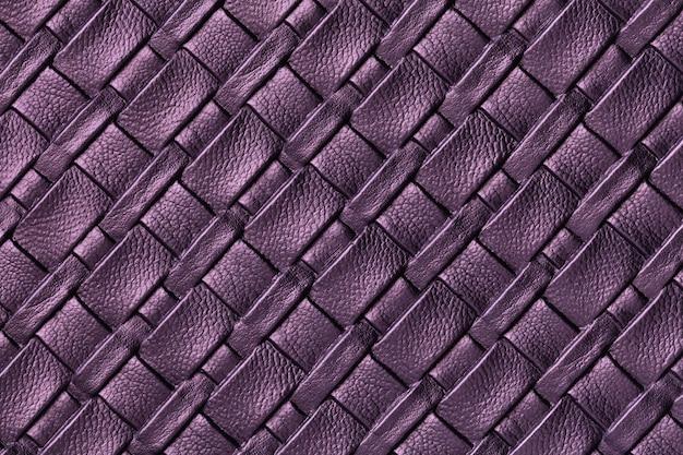 Текстура темно-фиолетового и бледно-лилового кожаного фона с плетеным узором