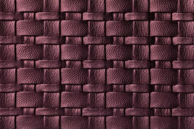 籐のパターンと濃い紫色の革の背景のテクスチャ