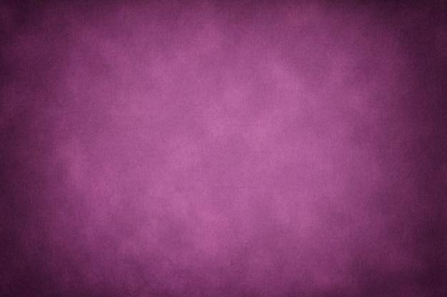 濃い紫色の古い紙のテクスチャ、ビネットでしわくちゃの背景