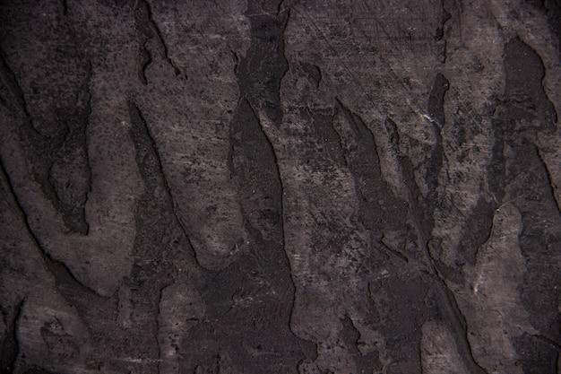 Текстура темной потертой цементной стены