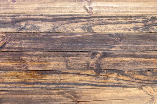 곡물과 천연 호두 색조가 있는 어두운 나무 판자의 질감.