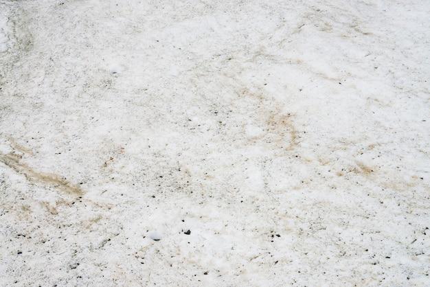 Текстура грязного снега крупным планом