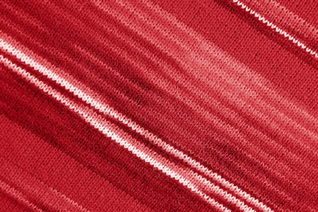 抽象的な背景のためのグラデーションの赤い縞模様のアルパカニットウール生地のテクスチャ